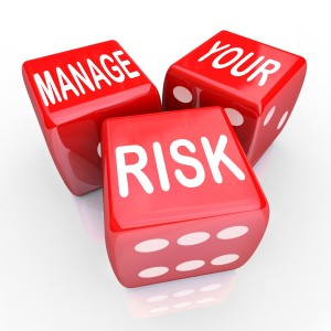 20329558 - manage your risk in a dangerous world, company, workplace or enterprise by reducing costs and liability, illustrated by these words on three red dice